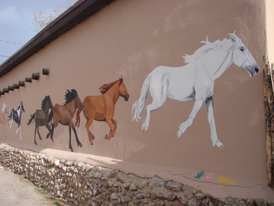 Other half of a horse mural on building.