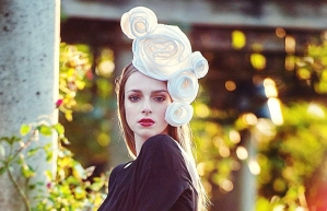 Photo credits: The Queen of Hearts headpiece, created by The Saucy Milliner for the Deighton Cup event, is made of handrolled sinamay roses. Photo by Abbye Dahl of afoto.ca for the Vancouver Sun.