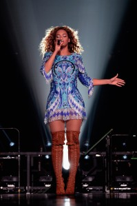 Beyonce performs on stage during 'The Mrs. Carter Show World Tour' at the Barclays Center in New York. Beyonce wears a blue dress and boots by Pucci and hosiery by Capezio. (Photo by Kevin Mazur/WireImage for Parkwood Entertainment).