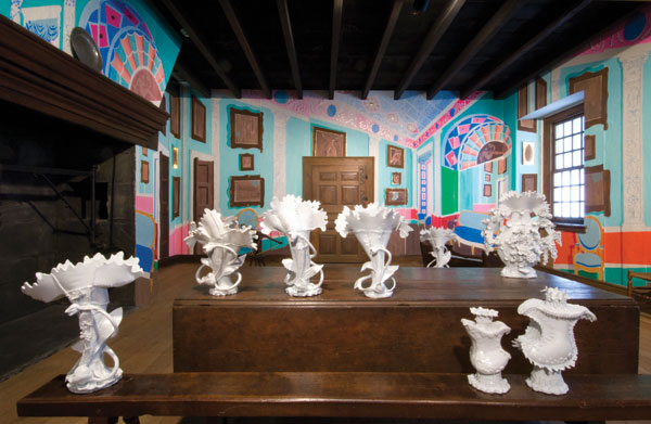 Ann Agee's installation Super Imposition (2010), at the Philadelphia Museum of Art, presents the artist's factory-like castings of rococo-style vessels in a re-created period room.