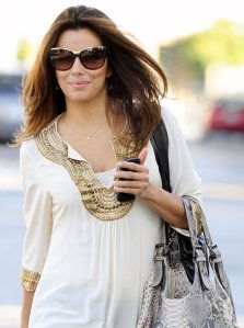 Eva Longoria looking gorgeous wearing a white beaded Akiko caftan tunic.