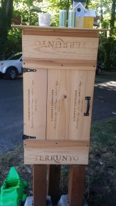 outdoor book dispensary from wood wine crates.