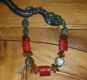a chunky turquouse/coral/amber neckpiece