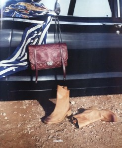 A twist on the Classics can't be all bad. Love the bag & distressed boots - Chanel.