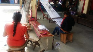 women weaving on back strap looms