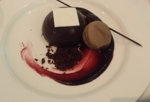 delicious chocolate mousse dessert with macaron