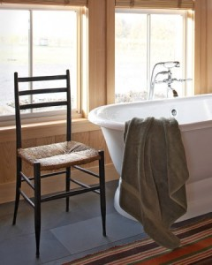 a simple cast-iron tub in a rustic barn home