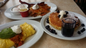 "Elmer's ""looking for sun"" omelette, blueberry buttermilk pancakes & potato pancakes."