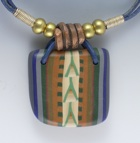 a necklace incorporating polymer clay with a western design