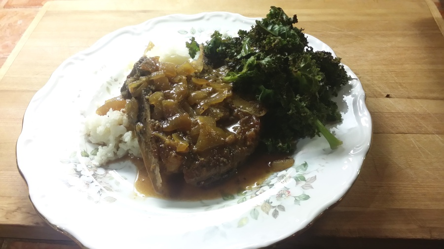 Maple Dijon Pork Chops seved over rice with side of crispy oven-baked kale. Photo: d. king