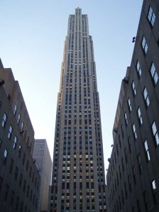 Rockefeller Center, including its centerpiece tower (seen here shortly before its 1933 opening and now familiarly known as 30 Rock) was primarily designed by architect Raymond Hood