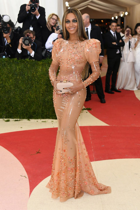 Beyoncé comes off her Lemonade launch in a pink-hued, form-fitting dress with floral embellishment by Givenchy.