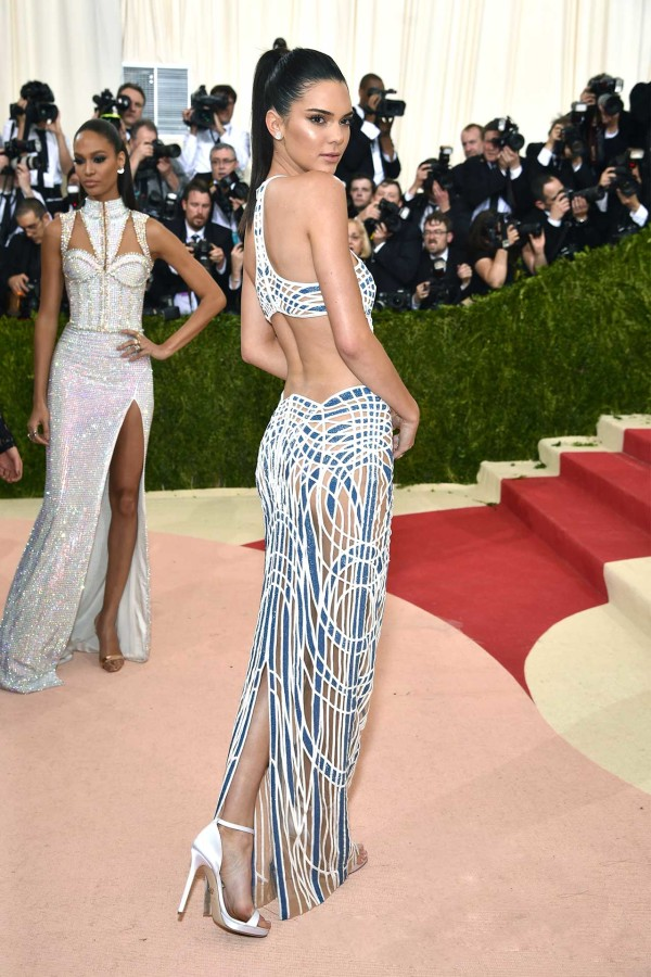 Kendall Jenner's Atelier Versace gown plays with laser-cut velvet and blue Swarovski crystals for a body-hugging statement.