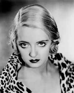 Bette Davis & her eyes wearing a classic leopard-print something or other.