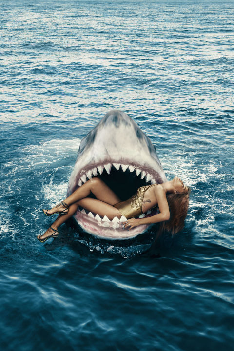 "Rihanna getting swallowed up on the cover of ""Harpers Bazaar"""