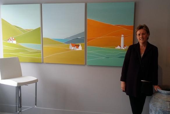 Georgina Masana stands next to her paintings
