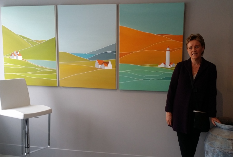 Georgina Masana stands next to her paintings