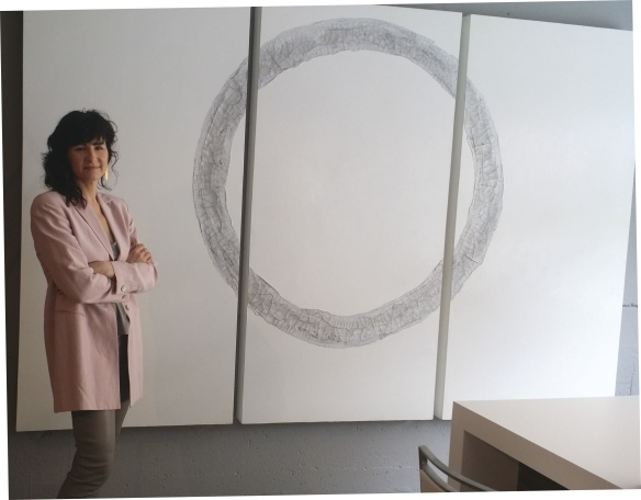 Tanya Slingsby stands beside one of her amazing works of ART