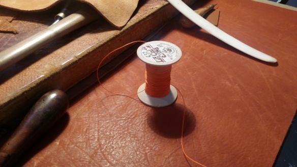 The Trademark Orange Thread