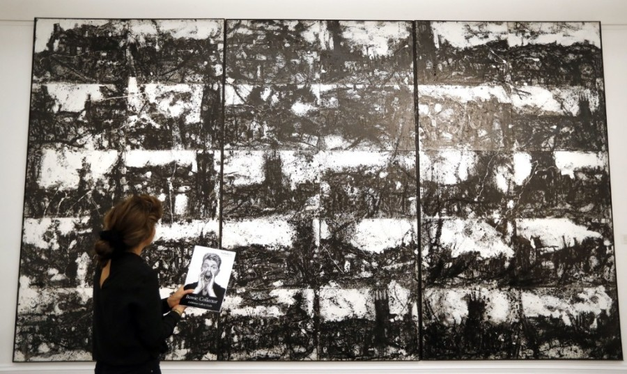 A painting by John Virtue called 'Landscape No. 87', part of the Bowie Collection on display at Sotheby's. AP Photo/Kirsty Wigglesworth