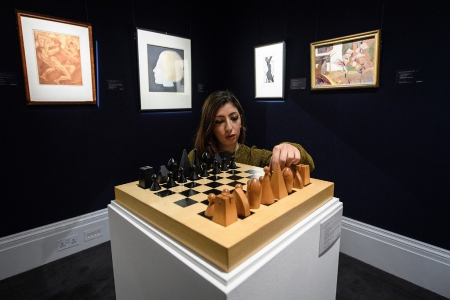 A gallery assistant poses with