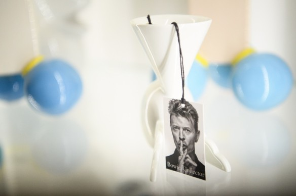 A photo of David Bowie on the auction labels of items during the press preview of the