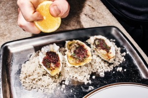 The oysters, about to be spritzed with lemon.Photo: Bobby Doherty/New York Magazine
