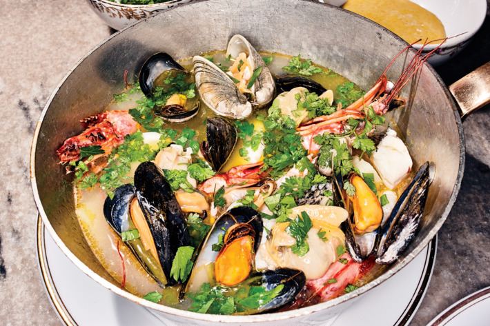 The bourride, stewing.Photo: Bobby Doherty/New York Magazine
