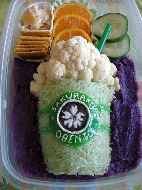 Frappucino: Chicken salad with toasted almonds, wheat crackers, tangerine wedges, cucumbers, cauliflower, rice, bits of Fruit Roll-Ups, and fondant over Okinawa sweet potato (naturally that purple!) Other food coloring used is vegetable-based colorants.