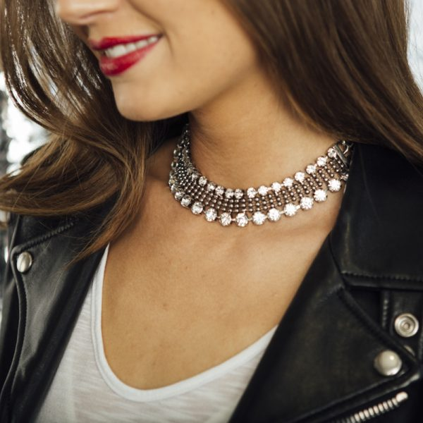 Opposites Attract An elegant statement necklace alongside a leather jacket makes forastylish cool-girl result.