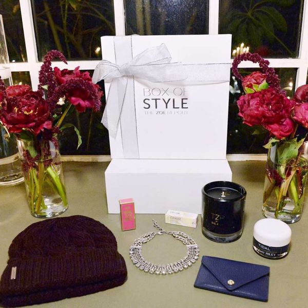 The full winter Box of Style on display, featuring a Soia & Kyo cable-knit hat, exclusive Dylanlex Zoey necklace, Clinique Lip Color and Primer in Berry Pop, D.L. & Co. custom The Zoe Report Birch candle, Dagne Dover exclusive leather card case and Sunday Riley Tidal Enzyme Brightening Water Cream.