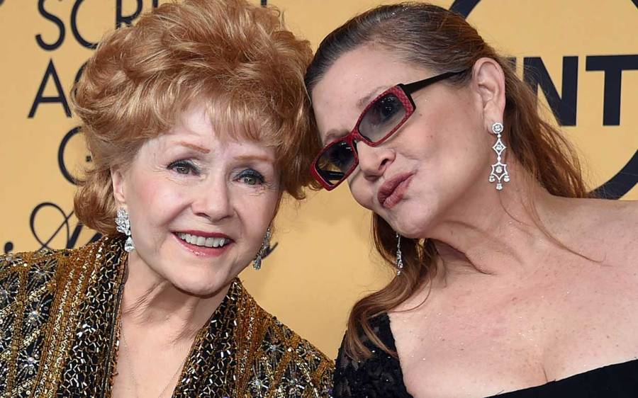 Debbie Reynolds, recipient of the Screen Actors Guild Life Achievement Award, and her daughter, actress Carrie Fisher, pose in the press room during the 21st Annual Screen Actors Guild Awards on January 25, 2015.(Ethan Miller/Getty Images)